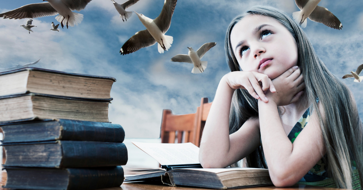 Girl with books that spark her imagination
